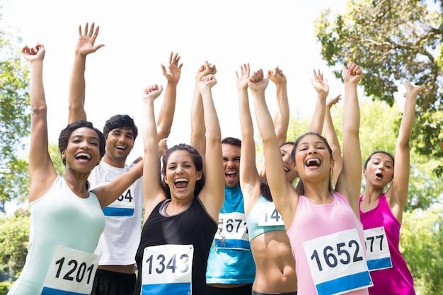 Marathon runners cheering in park