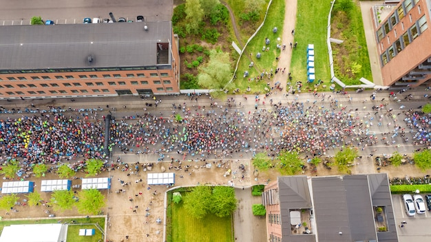 Marathon running race, aerial view of start and finish line with many runners