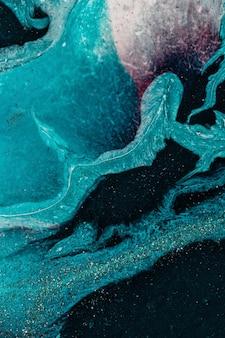 大理石アートの海の背景。スタイルは大理石の渦巻きや瑪瑙の波紋を取り入れています。ゴールドパウダーを使用したナチュラルラグジュアリー。垂直作物。
