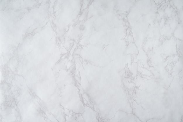 大理石の背景。灰色の影と白い石のテクスチャ。水平方向の形式。