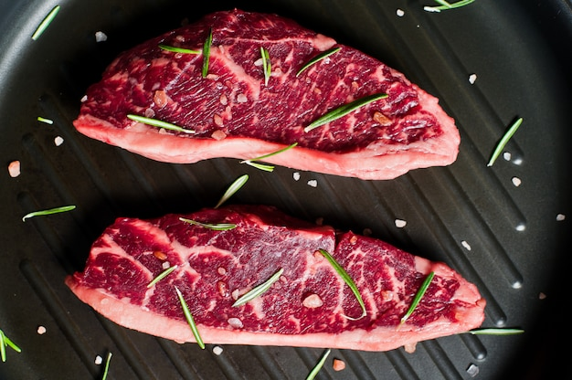 Marble beef steak black angus on the grill pan.