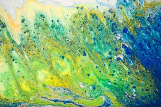 海の夏のスタイルの液体クローズアップインクの大理石の青と緑の抽象的な背景