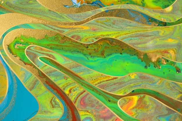 大理石の青と緑の抽象的な背景とゴールドのグラデーションの境界線