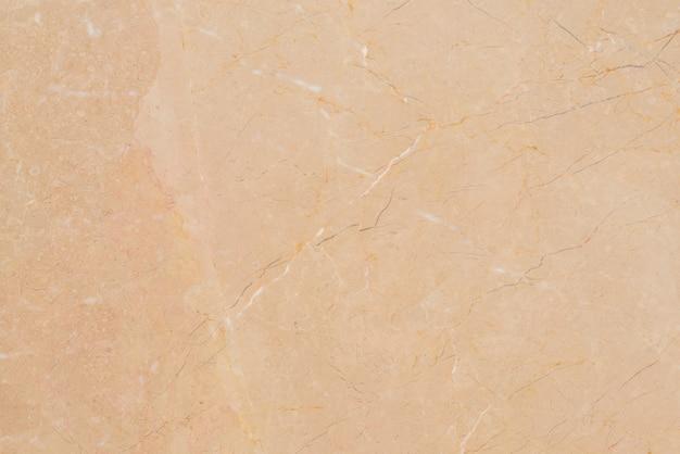 大理石の茶色の模様のテクスチャの背景に自然のパターンとデザインのための色、タイの抽象的な大理石。