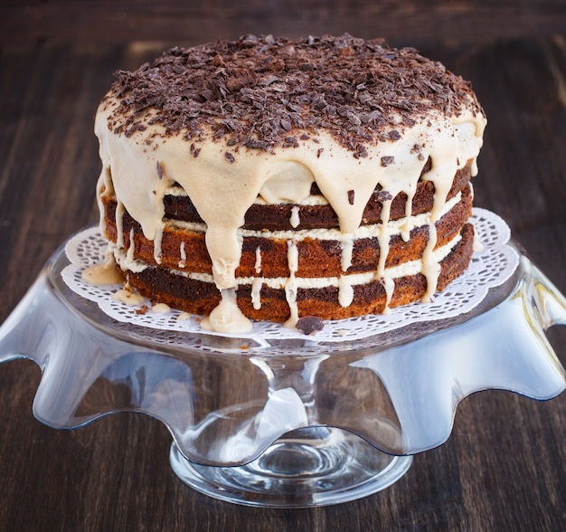 Marble cake with coffee beans, sprinkled with chocolate shavings.
