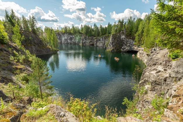 Marble canyon with tourist boats in ruskeala, karelia in summer.