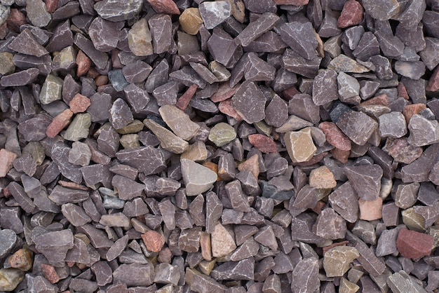 Marble chocolate stone chips, top view. stone textured background, decorative brown crushed stone for garden decoration.