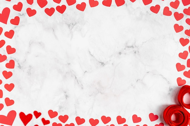 Marble copy space surrounded by hearts