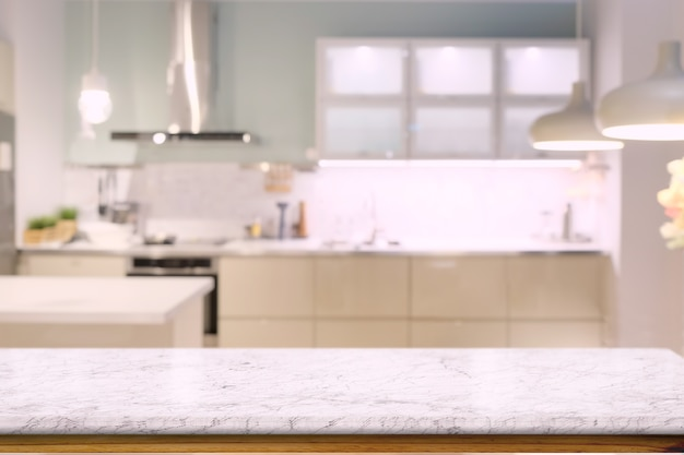 Marble counter top table with modern kitchen room background.