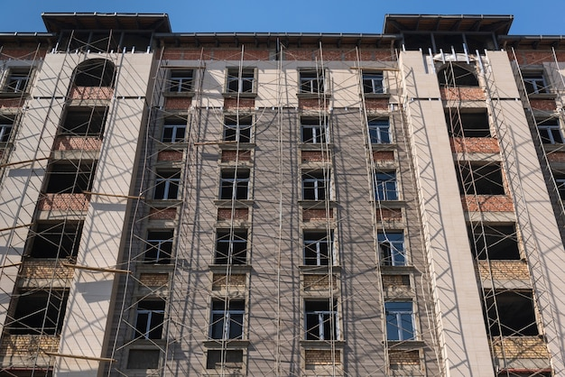 Marble finishing works on the facade of a high building