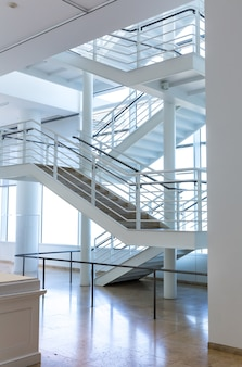 Marble floor and metal staircase.