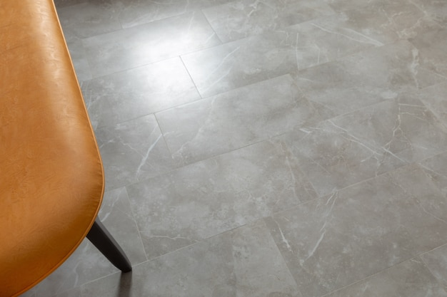 Marble floor and part of modern chair