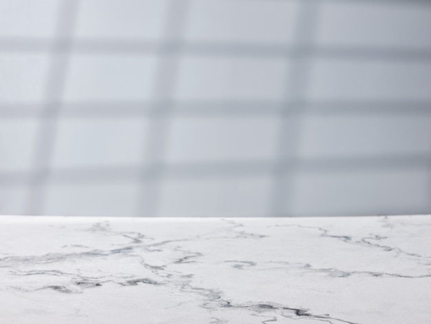 Marble table on gray wall background