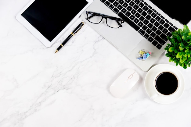 Marble white desk with blank notebook and other office supplies
