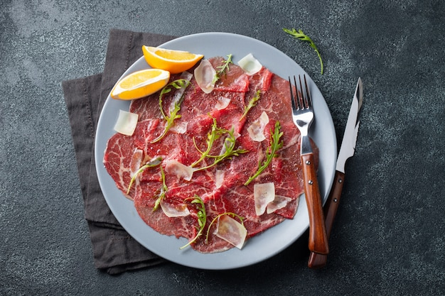 Marbled beef carpaccio with arugula and parmesan.
