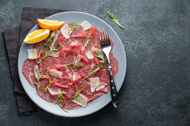 Marbled beef carpaccio with arugula.
