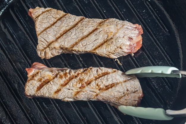 Marbled beef steak on a grill pan