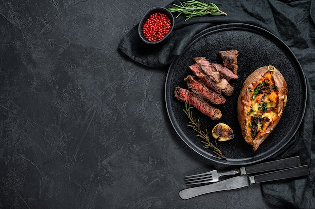 Marbled beef steak with baked sweet potato garnish. grilled meat