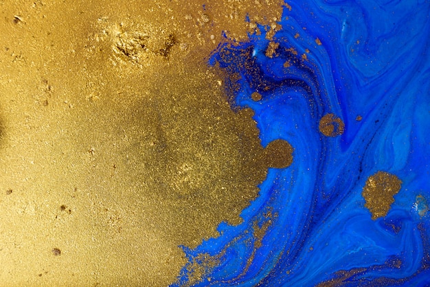 Marbled blue and gold abstract background. liquid marble pattern.