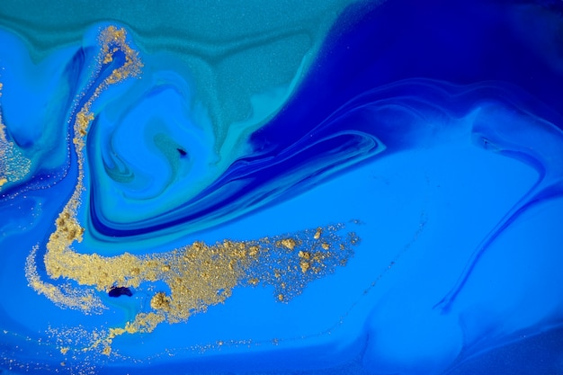 Marbled blue and gold abstract marble background
