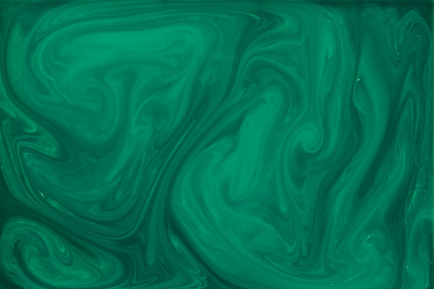 Marbled green fluid abstract background