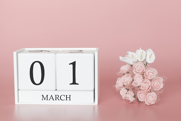 March 01st. day 1 of month. calendar cube on modern pink