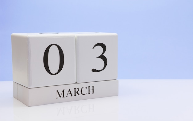 March 03st. day 03 of month, daily calendar on white table.