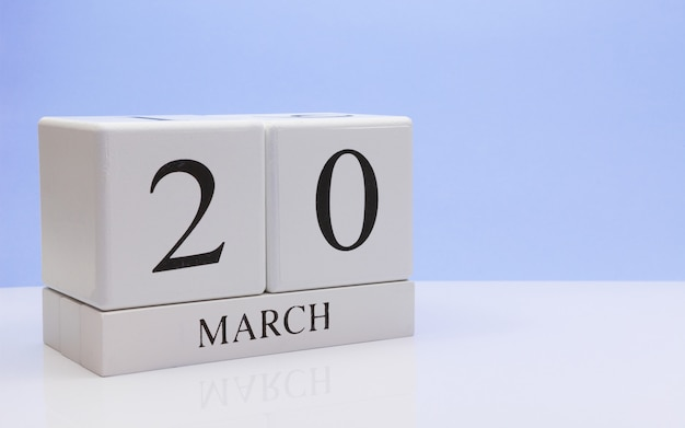 March 20st. day 20 of month, daily calendar on white table.