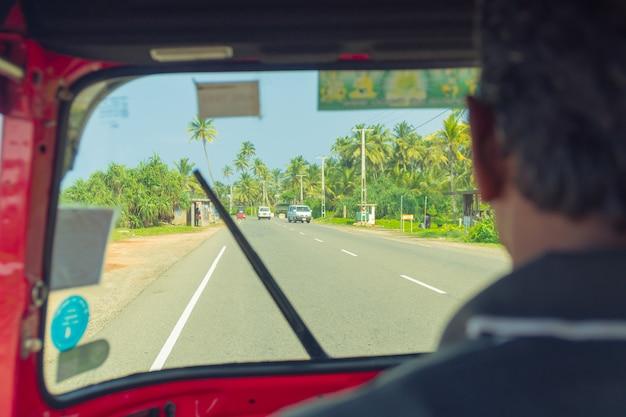 March 4, 2018. hikkaduwa, sri lanka. tuk-tuk driver in the cockpit