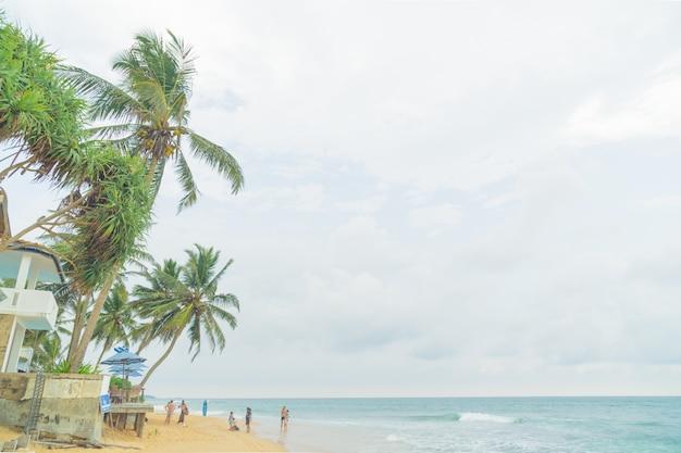 March 4, 2018. hikkauwa, sri lanka. people on the beach.