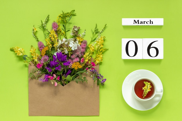 March 6. cup of herbs tea, kraft envelope with multi colored flowers
