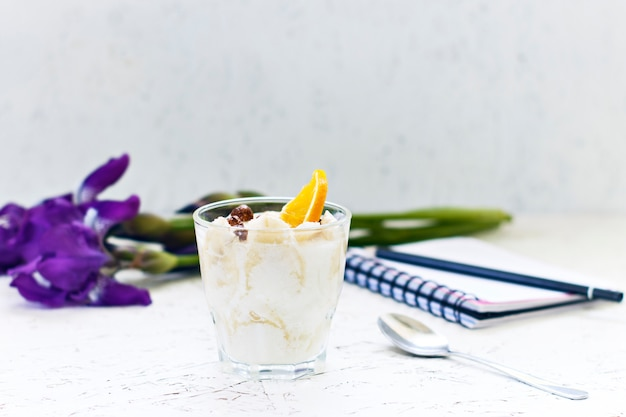 March 8. women's day. morning. breakfast. flowers irises with a notebook and creamy dessert