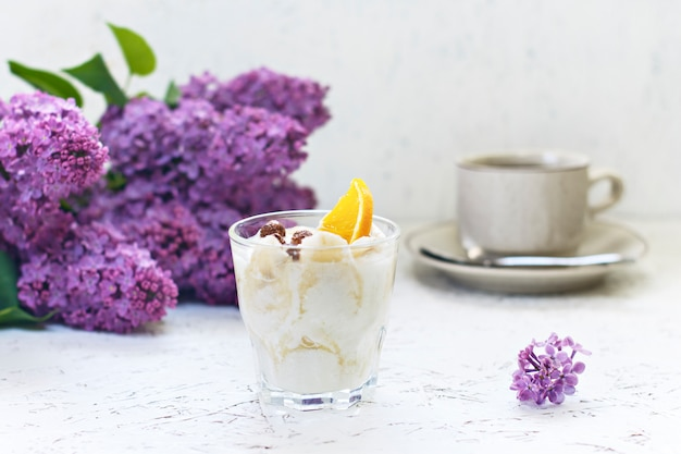 March 8. women's day. morning. breakfast. lilac with coffee and creamy dessert