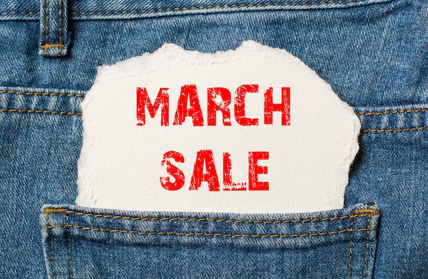 March sale on white paper in the pocket of blue denim jeans