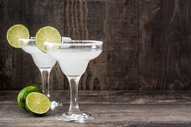 Margarita cocktail in glass on wooden table copy space