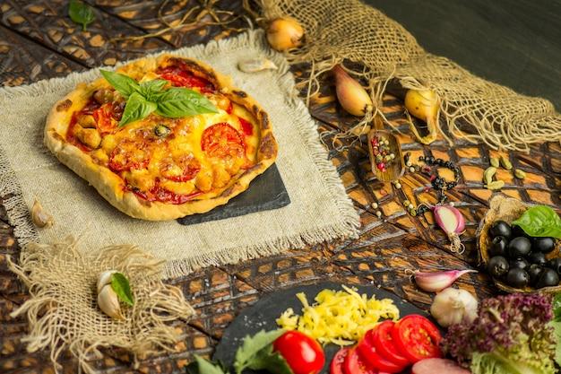 Margarita pizza with ham mushrooms and ketchup