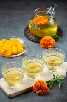 Marigold, lemon, honey herbal tea treatment concept.