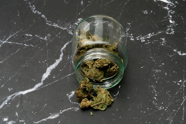 Marijuana cannabis medicinal, weed joint in a glass container, drugs.