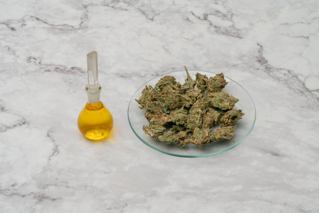 Marijuana cannabis medicinal, weed joint in a glass container. medical extract of cannabis marijuana oil in jar