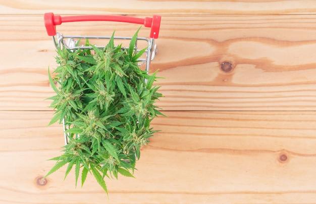 Marijuana flower in shopping cart on table