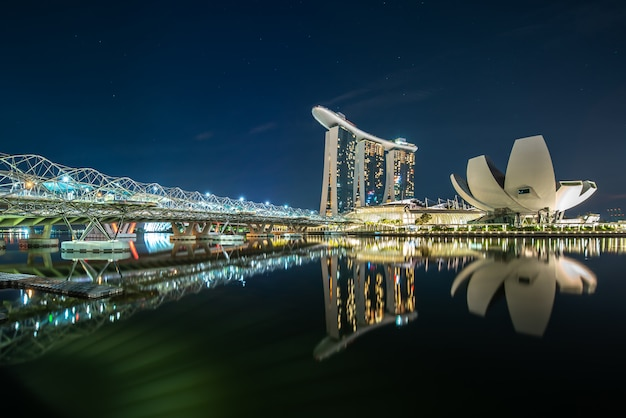 Marina bay at night reflected in the water