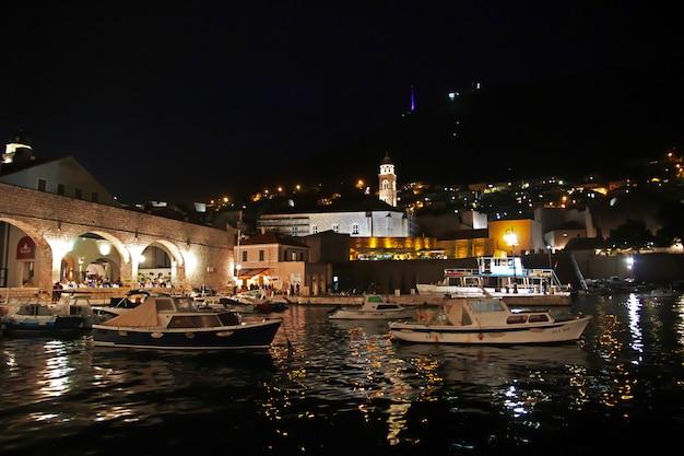 The marina at night in dubrovnik city on adriatic sea, croatia