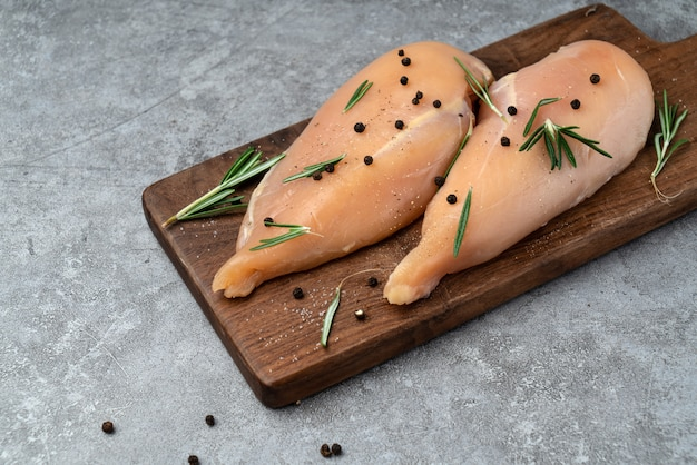Marinate the fresh chicken breast on the cutting board