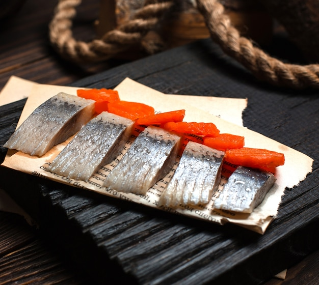 Marinated herring with fried carrots