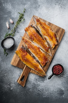 Marinated mackerel with paprika and saffron on grey surface, top view.