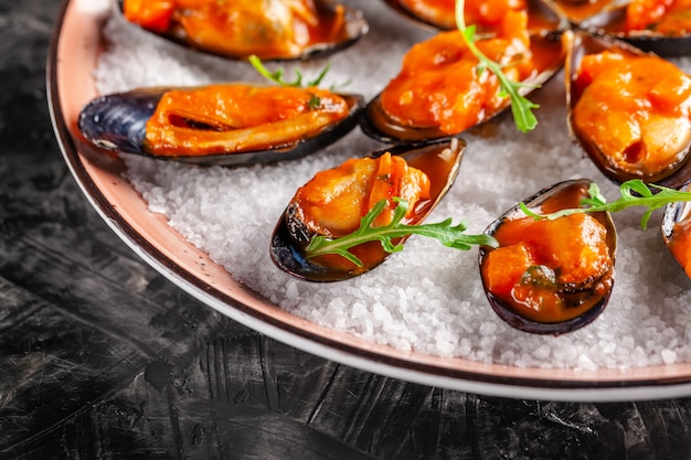 Marinated mussels in tomato sauce.