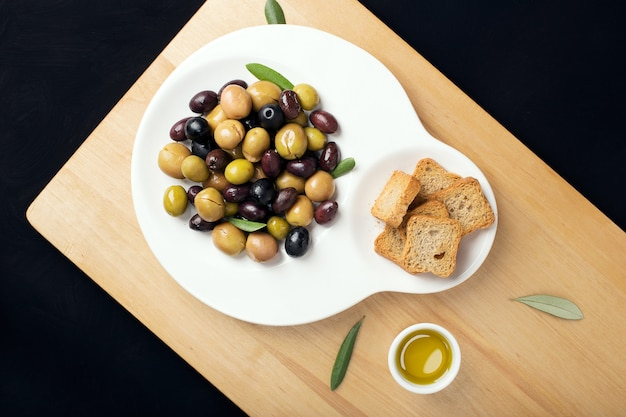 Marinated olives in plate