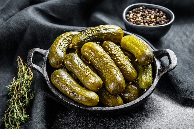 Marinated pickled cucumbers with herbs and spices
