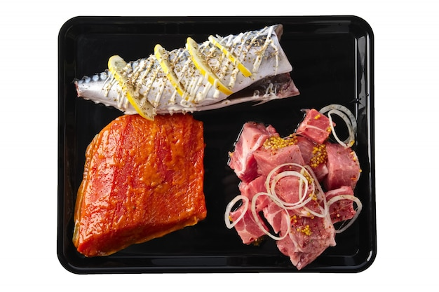 Marinated varieties of meat and fish ready for grilling isolated