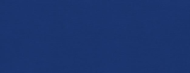 マリンブルーのキャンバスのテクスチャ背景
